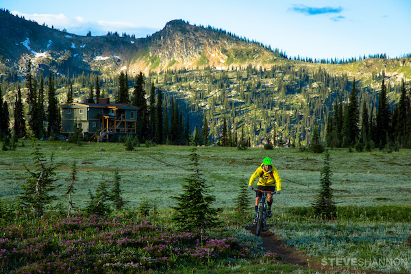 A mountain biker enjoys pristine alpine singletrack right out the door of the lodge at Sol Mountain Lodge in the Monashee mountains near Revelstoke, British Columbia.