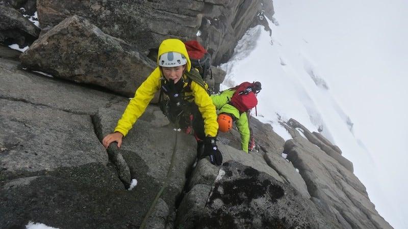 Boy climbing rock face